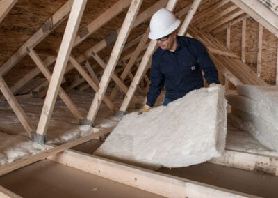 Austin Company   installing fiberglass in attic of residential home