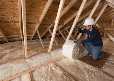 Austin Company   installing fiberglass in attic of home